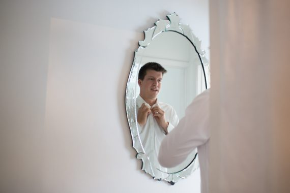 Groom getting dressed before his wedding in Henley
