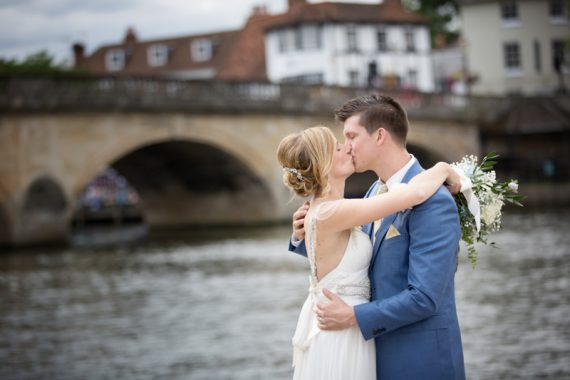 Bride and Groom standing by the River Thames at Henley Wedding
