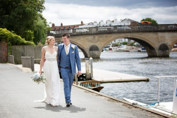 Bride and Groom looking happy outside Leander Club in Henley