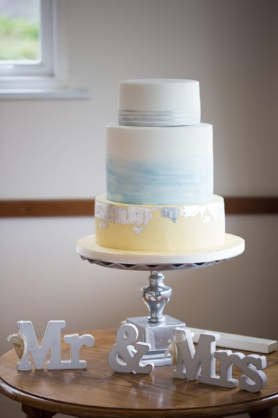 Beautiful wedding cake in blue and yellow colour scheme