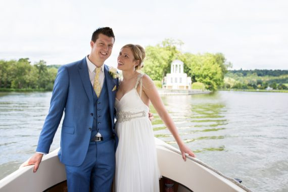Bride and Groom looking happy at their wedding in Henley with Temple Island in background