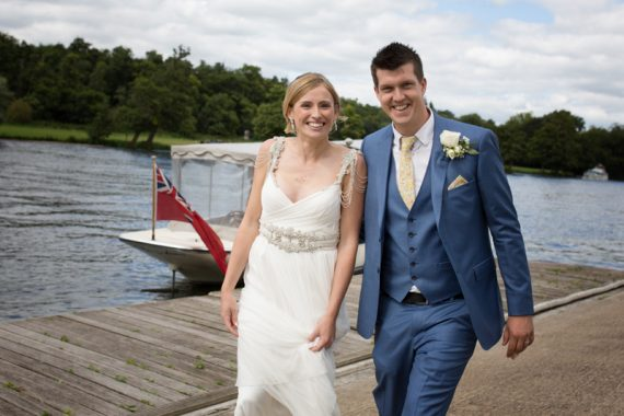 Happy bride and groom by the river in Henley