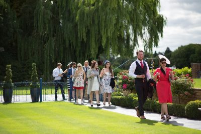 Wedding guests looking stylish at Remenham Club wedding in Henley