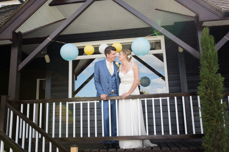 Bride and Groom looking happy at their wedding at Remenham Club by the River Thames in Henley