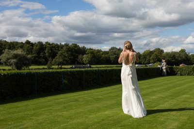 Bride in the grounds of Remenham Club wedding at Henley