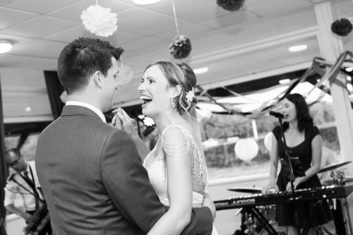 Brie and Groom looking happy during wedding at Remenham Club in Henley