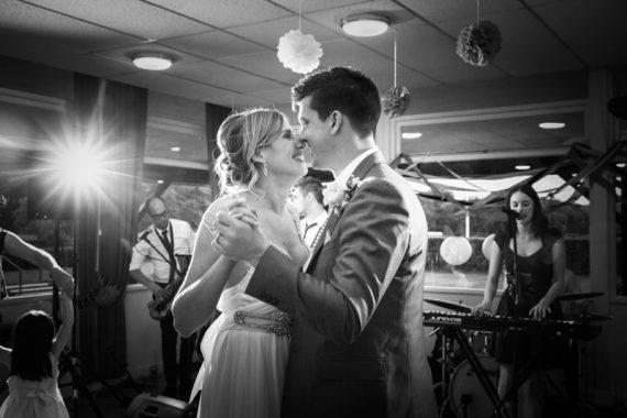 Bride and Groom enjoying their first dance at wedding at Remenham Club in Henley