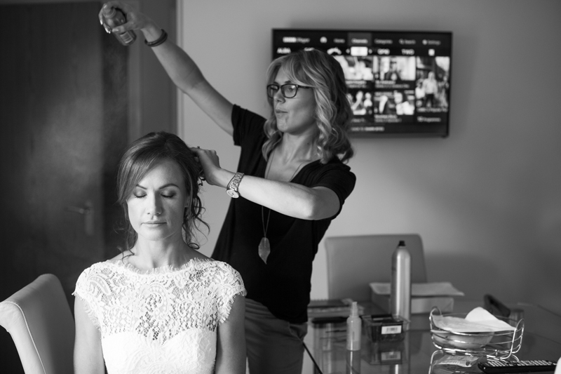 Bride getting her hair spray during bridal prep