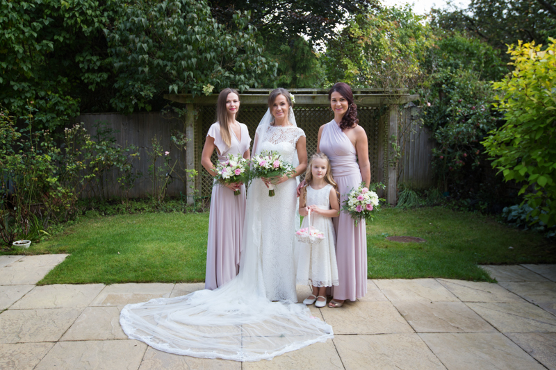 Bride and her bridal party in garden ready to get married