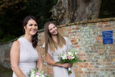 Bridesmaids waiting outside St Dustan's Church in Monks Risborough