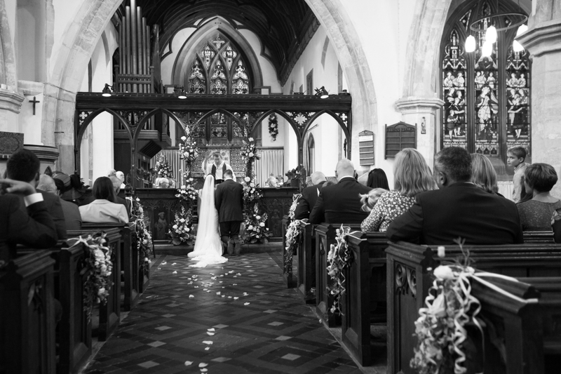Bride and Groom in their wedding at St Dustan's Church in Monks Risborough