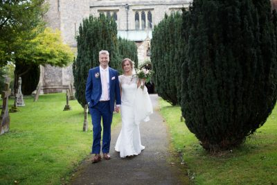 Bride and Groom in grounds of St Dustan's Church in Monks Risborough