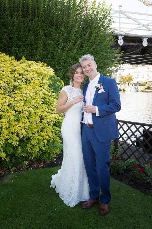 Portrait of bride and groom with Marlow bridge in the background