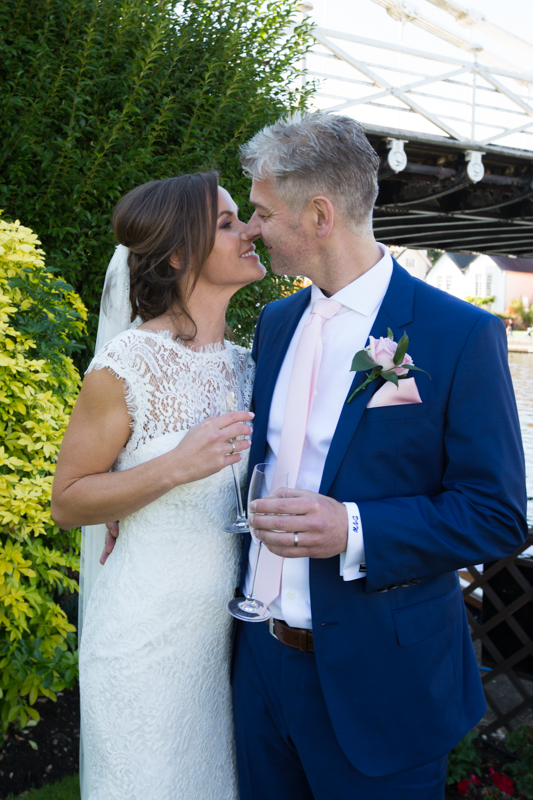 Romantic portrait of bride and groom at their wedding in Marlow