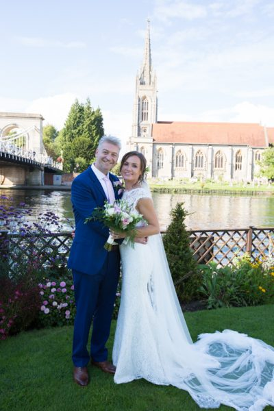Bride and Groom portrait in garden of Compleat Angler Hotel in Marlow