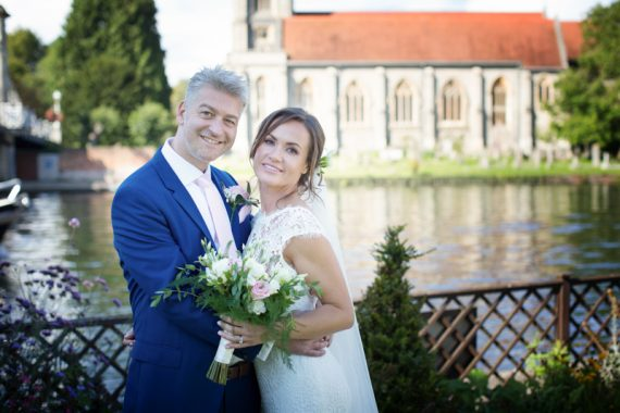 Portrait of bride and groom with Marlow church in the background