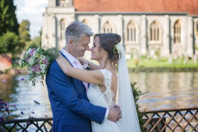 Bride and Groom looking happy at their wedding at Compleat Angler in Marlow