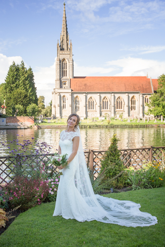 Bride posing at her wedding at Compleat Angler in Marlow
