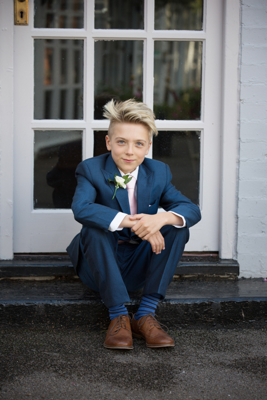 Boy in a wedding suit at Compleat Angler in Marlow