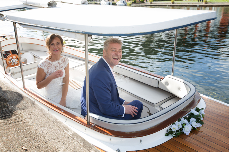 Bride and Groom on hotel launch outside Compleat Angler in Marlow