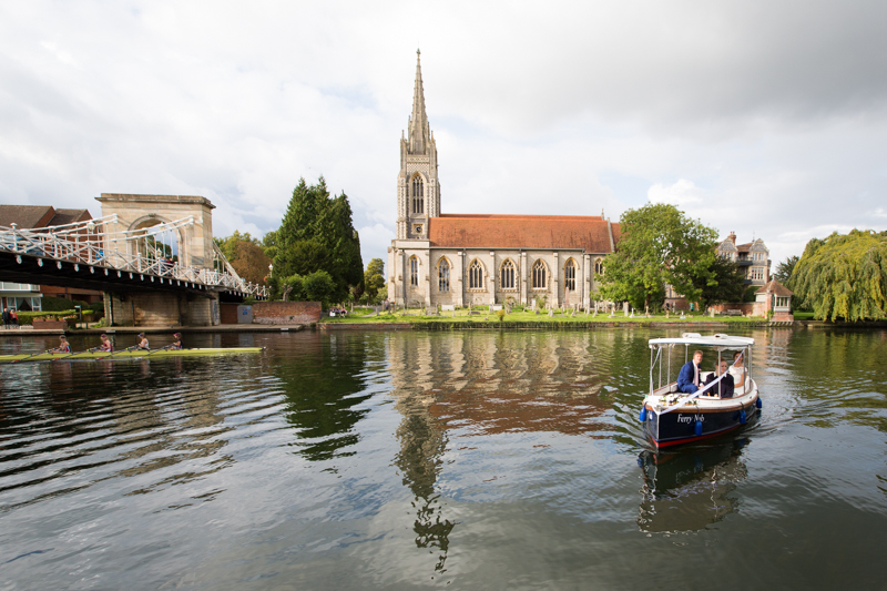 Bride and Groom on launch in front of Compleat Angler in Marlow