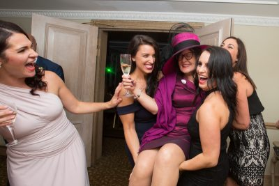 Girls holding up guest at wedding at Compleat Angler in Marlow