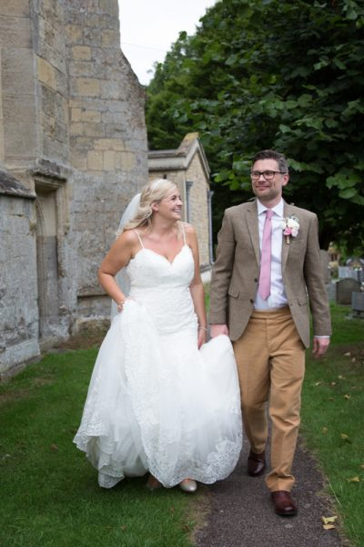 Natural portrait of bride and groom outside St Mary's Church in Thame