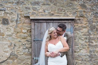 Bride and Groom looking happy at their wedding at Thame Tythe Barns