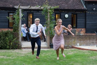Guests having a race at a wedding at Thame Tythe Barn