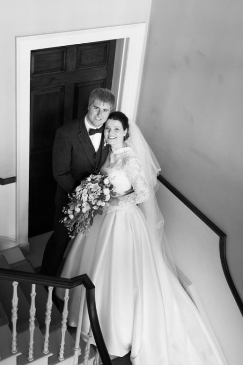 Bride and Groom on the stairs at Marsh Baldon Manor House
