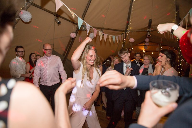 Girl dancing at a marquee wedding in Henley