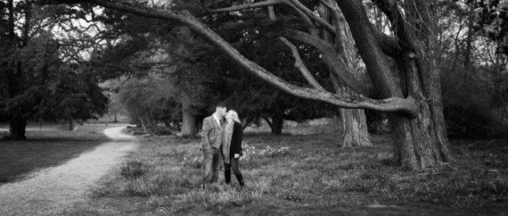 Couple kissing during their pre wedding shoot at Eynsham Hall