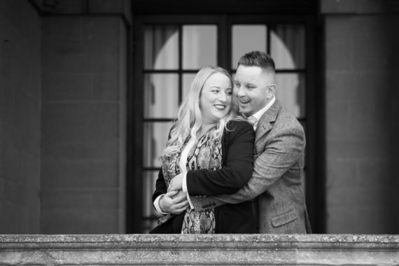 Couple looking relaxed and happy at pre wedding shoot at Eynsham Hall