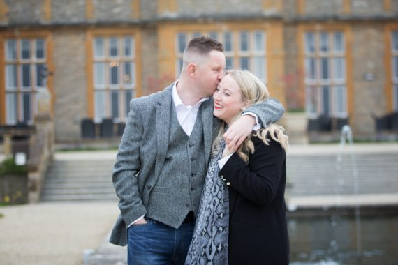 Couple kissing on their pre wedding shoot at Eynsham Hall