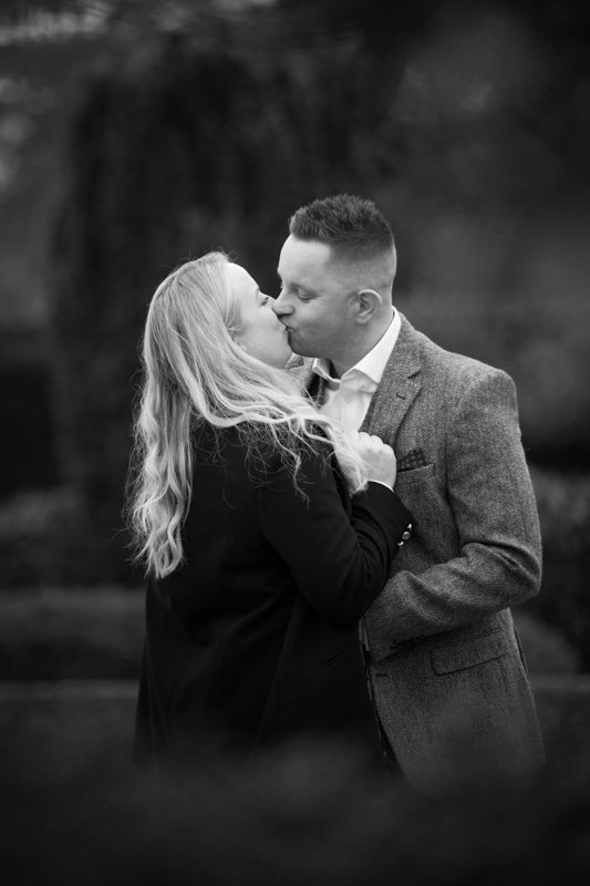 Couple kissing during their pre wedding shoot at Oxfordshire Wedding Venue, Eynsham Hall