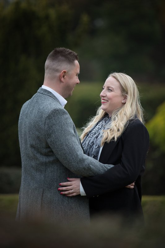Couple looking happy during their pre wedding shoot at Eynsham Hall in Oxfordshire