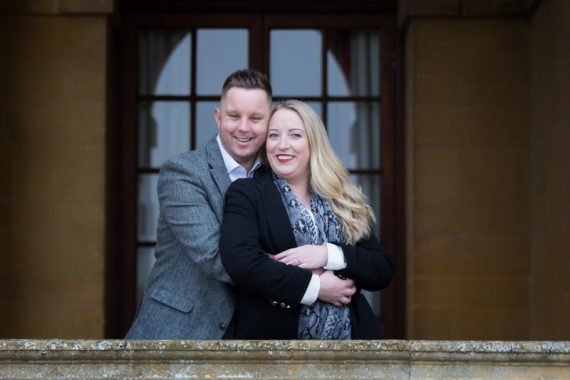 Couple looking happy during their pre wedding shoot at Eynsham Hall, oxfordshire wedding venue
