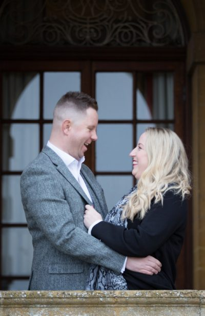 Couple looking happy at their pre wedding shoot at Eynsham Hall in Oxfordshire