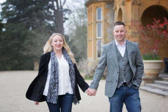 Couple walking in the grounds of Eynsham Hall, a beautiful wedding venue in Oxfordshire