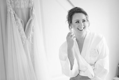 Bride looking relaxed getting ready for her wedding in Henley on Thames